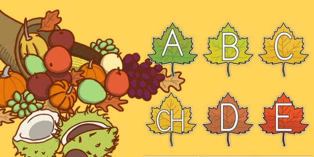 Alfabeto en hojas de otoño